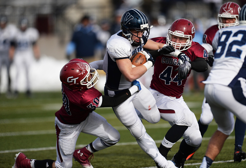 . AURORA CO. NOVEMBER 23 : Christian McCaffrey of Valor Christian High School (5) rushes against Mar\'keith Bailey (30) and Kaleb Barnum (44) of Cherokee Trail High School during the 5A football semifinal game at Legacy Stadium in Aurora, Colorado November 23, 2013. Valor Christian won 42-23. (Photo by Hyoung Chang/The Denver Post)