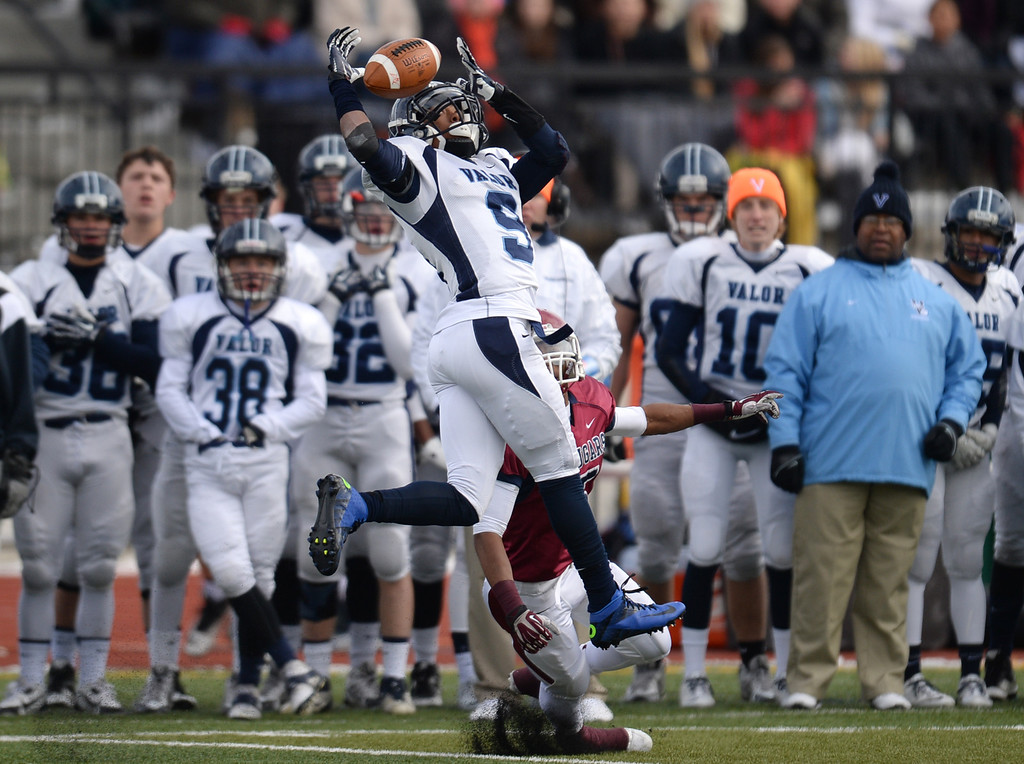 . AURORA CO. NOVEMBER 23 : Brain Dawkins Jr. of Valor Christian High School (9) breaks up a catch for Dominique Grady of Cherokee Trail High School (5) during the 5A football semifinal game at Legacy Stadium in Aurora, Colorado November 23, 2013. Valor Christian won 42-23. (Photo by Hyoung Chang/The Denver Post)