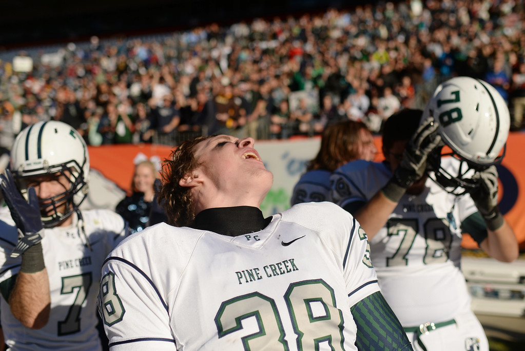 . Alex Wandell of Pine Creek High School (38) celebrates winning of 4A State Football Championship game against Montrose High Shool at Sports Authority Field. Denver, Colorado. November 30. 2013. Pine Creek won 49-14. (Photo by Hyoung Chang/The Denver Post)