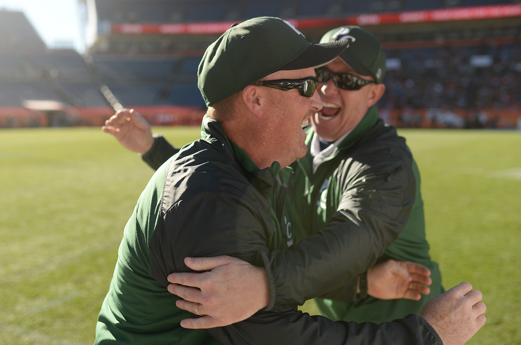 . Head coach Todd Miller of Pine Creek High School, front, celebrates winning of 4A State Football Championship game against Montrose High School at Sports Authority Field. Denver, Colorado. November 30. 2013. Pine Creek won 49-14. (Photo by Hyoung Chang/The Denver Post)