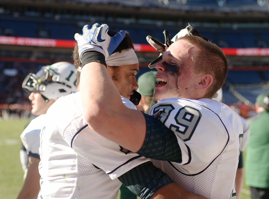 . Austin Schultz (39), right, and Avery Anderson-Baer (1) of Pine Creek High School celebrate winning of 4A State Football Championship game against Montrose High School at Sports Authority Field. Denver, Colorado. November 30. 2013. Pine Creek won 49-14. (Photo by Hyoung Chang/The Denver Post)