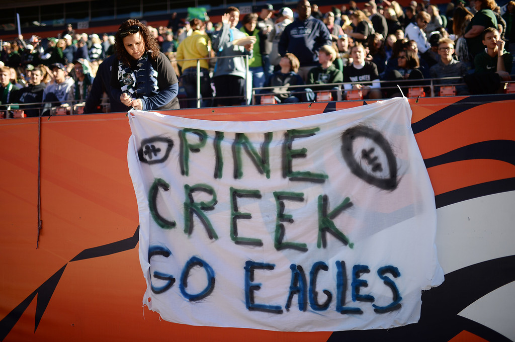 . Gracee Liggett is setting the banner for Pine Creek High School for the 4A State Football Championship game against Montrose High School at Sports Authority Field. Denver, Colorado. November 30. 2013. (Photo by Hyoung Chang/The Denver Post)