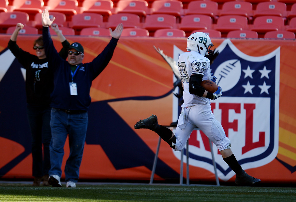 . Austin Schultz of Pine Creek High School (39) scores a touchdown in the 3rd quarter of 4A State Football Championship game against Montrose High School at Sports Authority Field. Denver, Colorado. November 30. 2013. Pine Creek won 49-14. (Photo by Hyoung Chang/The Denver Post)