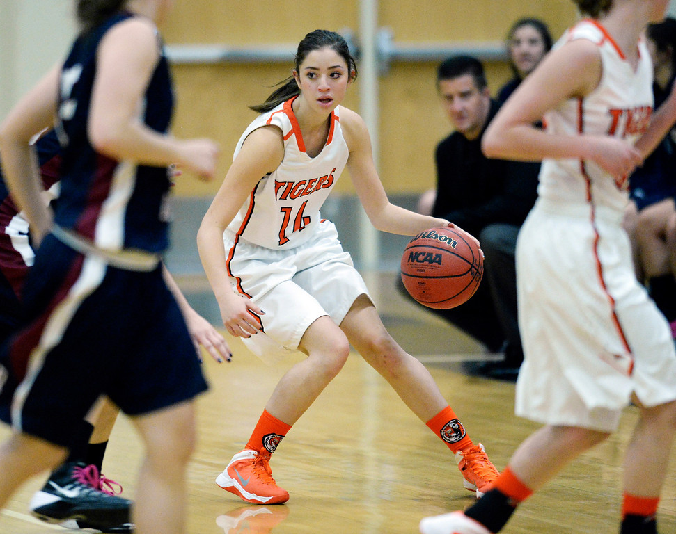 . Lakewood sophomore guard Anissa Barela (14) worked the perimeter in the second half. T  Photo By Karl Gehring/The Denver Post