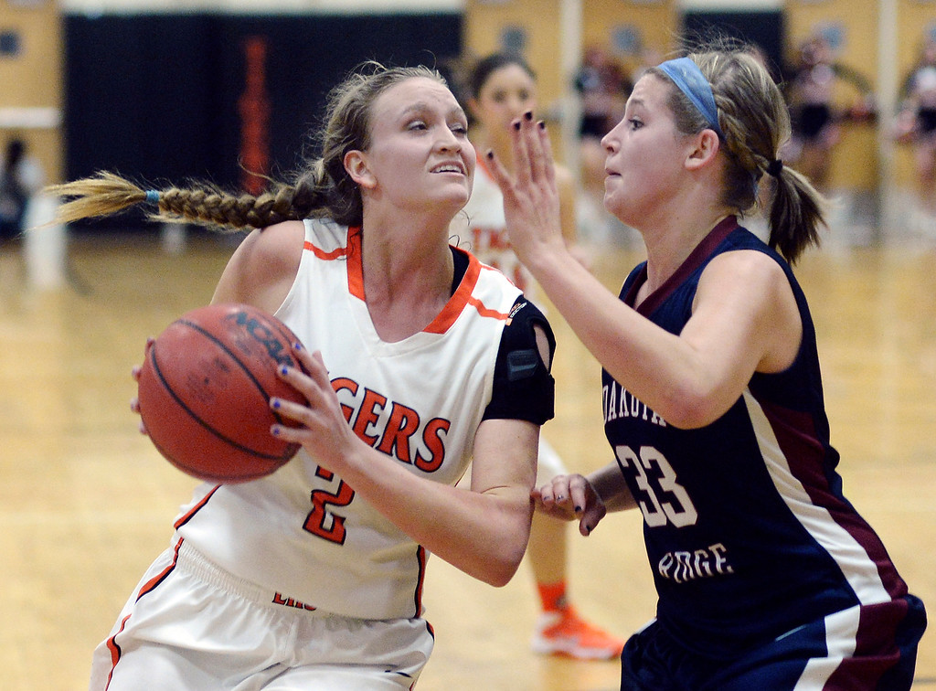 . Tigers\' senior forward Jessica Brooks (2) drove the lane on Dakota Ridge\'s Jae Ferrin (33) in the first half.   Photo By Karl Gehring/The Denver Post