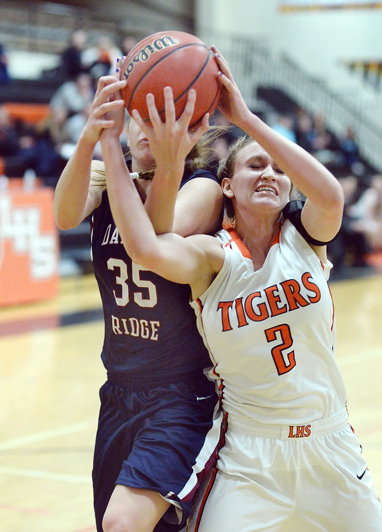 . Dakota Ridge junior Jessica LeBaron (35) battled for a rebound with Tiger\'s senior forward Jessica Brooks (2) in the first half.  . Photo By Karl Gehring/The Denver Post