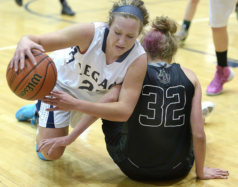 . WESTMINSTER, CO. - JANUARY 23:  Legacy junior guard Bree Paulson (25) saves a ball from going out of bounds in the second half. The Fossil Ridge High School girl\'s basketball team defeated Legacy 61-52 Thursday night, January 23, 2014. Photo By Karl Gehring/The Denver Post