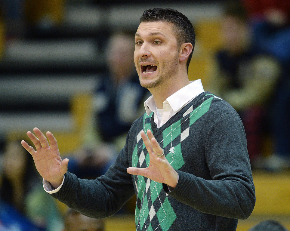 . WESTMINSTER, CO. - JANUARY 23:  Fossil Ridge coach Chad Salz shouted instructions from the bench in the second half. The Fossil Ridge High School girl\'s basketball team defeated Legacy 61-52 Thursday night, January 23, 2014. Photo By Karl Gehring/The Denver Post