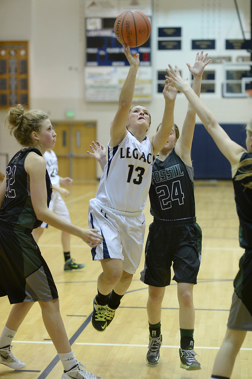 . WESTMINSTER, CO. - JANUARY 23:  Legacy guard Maddie Gallegos (13) drove the lane for a basket in the second half. The Fossil Ridge High School girl\'s basketball team defeated Legacy 61-52 Thursday night, January 23, 2014. Photo By Karl Gehring/The Denver Post