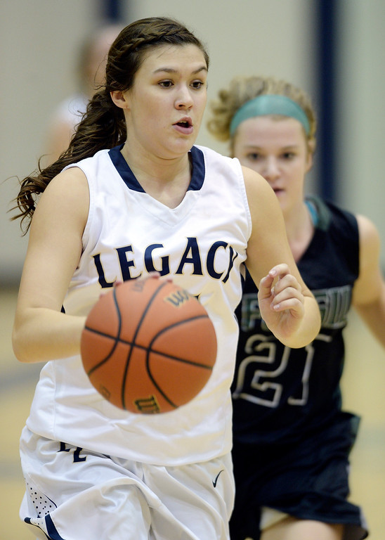 . WESTMINSTER, CO. - JANUARY 23:  Lagacy senior guard Jenna Fenton (15) moved the ball downcourt Thursday night. The Fossil Ridge High School girl\'s basketball team defeated Legacy 61-52 Thursday night, January 23, 2014. Photo By Karl Gehring/The Denver Post
