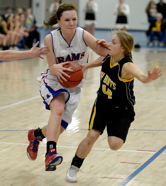 . Akron\'s Jordan Baer (1) drives on Caliche\'s Jaedyn Lambrecht (4) in 1A/2A action February 13, 2014 in Akron. Taylor was called for a foul on the play. (Photo by John Leyba/The Denver Post)
