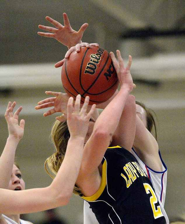 . Caliche\'s Jenna Zink (2) gets fouled during the second quarter in 1A/ 2A action against Akron February 13, 2014 in Akron. (Photo by John Leyba/The Denver Post)