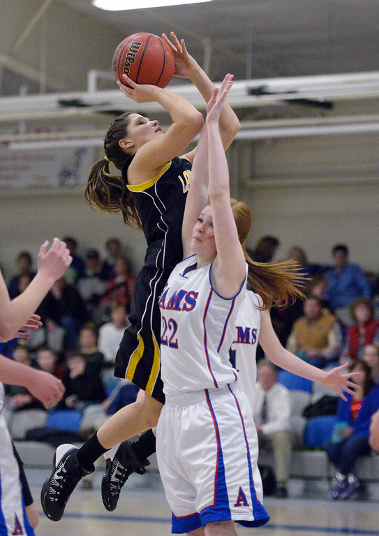 . Caliche\'s Rachael Edler (10) takes a shot over Akron Lizzie Alonso Holtorf (22) in 1A/2A action February 13, 2014 in Akron. (Photo by John Leyba/The Denver Post)