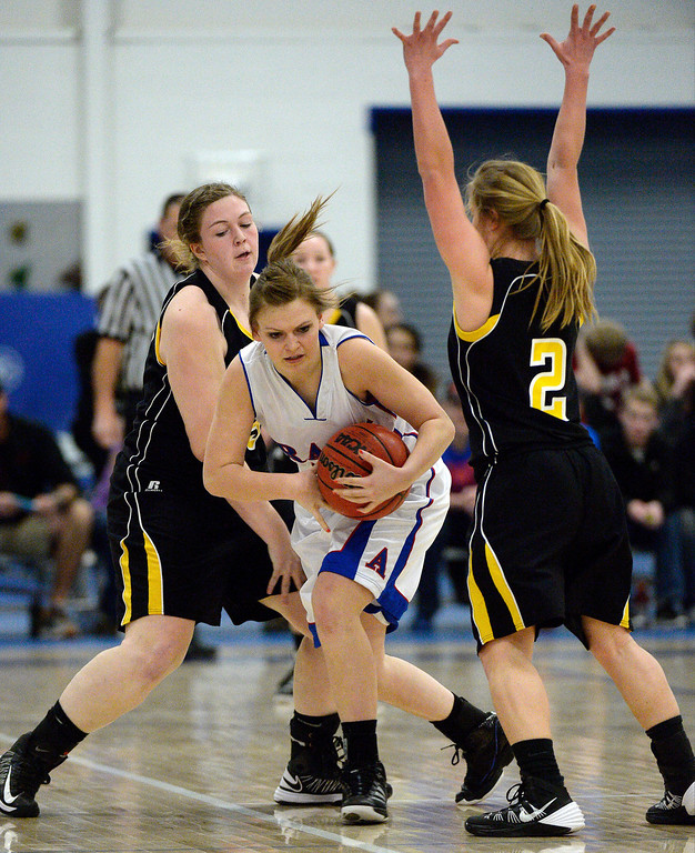 . Akron Karli Christensen (12) gets double teamed by Caliche\'s Jessica Taylor (35) and Jenna Zink (2) in 1A/2A action February 13, 2014 in Akron. (Photo by John Leyba/The Denver Post)
