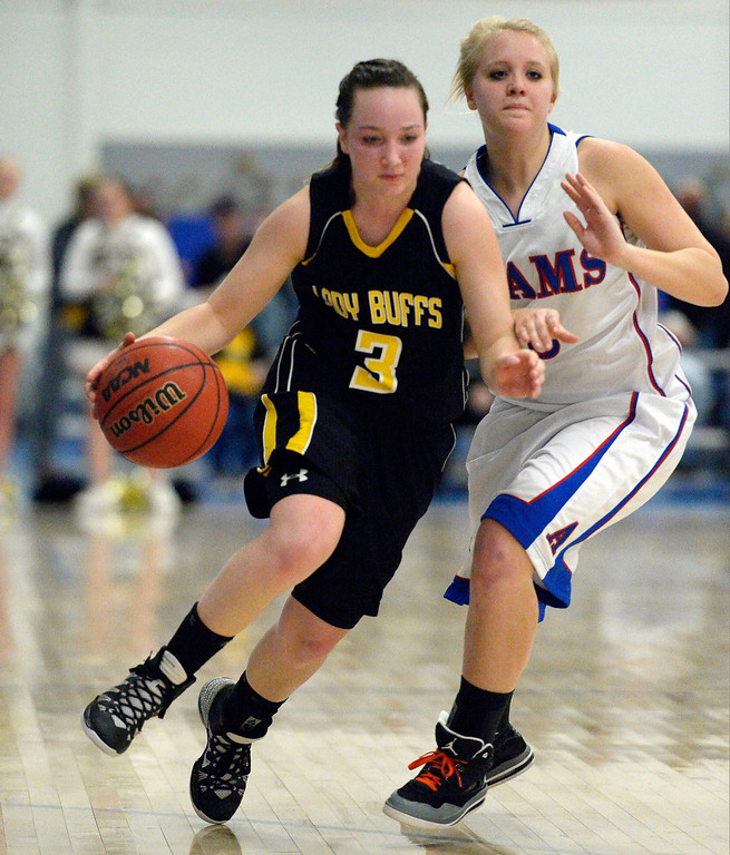 . Caliche\'s Shaylin Johnson (3) drives past Akron\'s Gail Hall (2) in 1A/2A action February 13, 2014 in Akron. (Photo by John Leyba/The Denver Post)