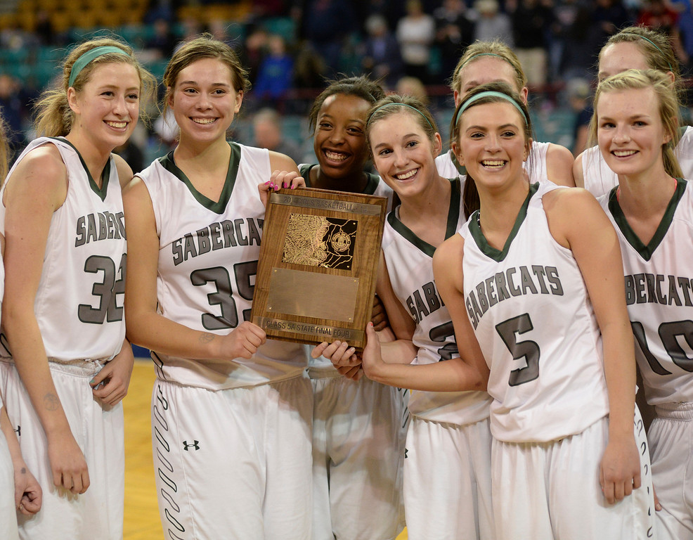 . DENVER, CO. - MARCH 6, 2014: The SaberCats posed with their trophy after the win Thursday night. The Fossil Ridge School girl\'s basketball team defeated Dakota Ridge 60-50 in a 5A playoff game Thursday night, March 6, 2014 at the Denver Coliseum. Photo By Karl Gehring/The Denver Post