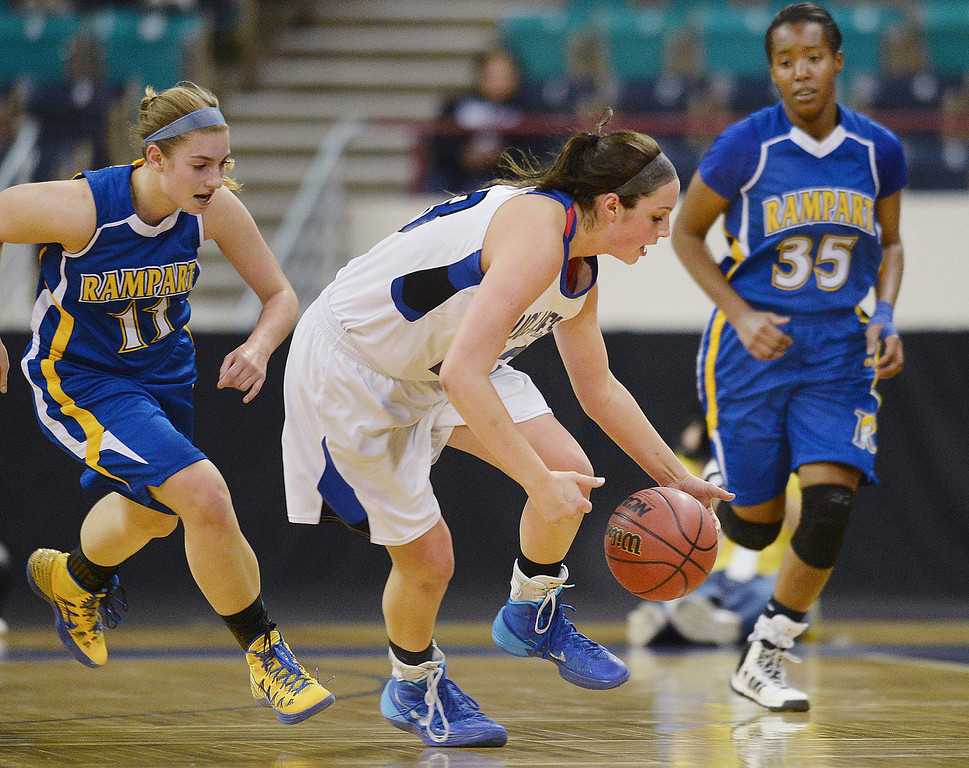 . Grandview senior guard Katie Cunningham (23) made a steal in the first half. The Grandview High School girl\'s basketball team took on Rampart in a 5A playoff game Thursday night, March 6, 2014 in Denver, Colorado. (Photo by Karl Gehring/The Denver Post)