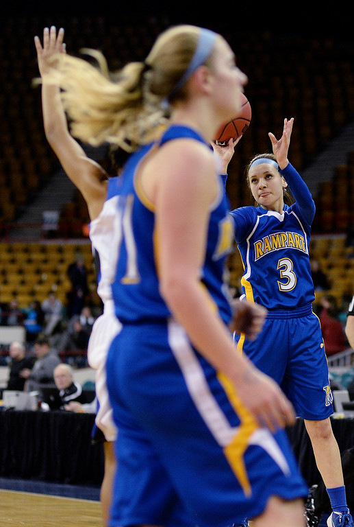 . Rampart senior guard Megan Kavalec (3) put up a shot in the first half. The Grandview High School girl\'s basketball team took on Rampart in a 5A playoff game Thursday night, March 6, 2014 in Denver, Colorado. (Photo by Karl Gehring/The Denver Post)