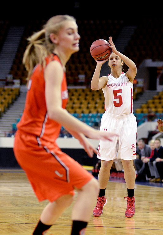 . Regis guard Anna Ptaskinski (5) had an open shot in the first quarter. The Regis Jesuit High School girl\'s basketball team faced Lakewood in a 5A playoff game Thursday night, March 6, 2014 in Denver, Colorado. (Photo by Karl Gehring/The Denver Post)