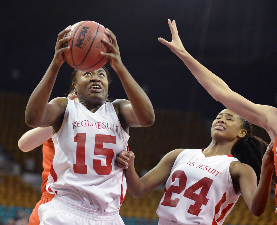 . Regis senior Diani Akigbogun (15) secured a rebound in the first quarter. The Regis Jesuit High School girl\'s basketball team faced Lakewood in a 5A playoff game Thursday night, March 6, 2014 in Denver, Colorado. (Photo by Karl Gehring/The Denver Post)