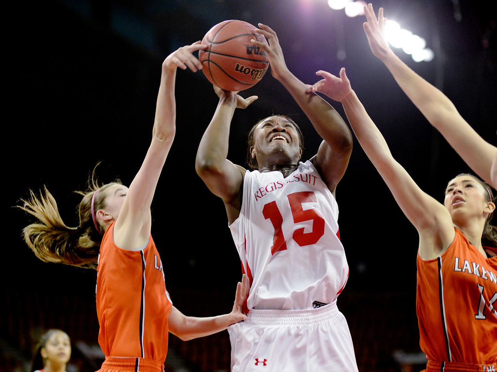 . Raiders senior Diani Akigbogun (15) worked under the basket in the first half. The Regis Jesuit High School girl\'s basketball team faced Lakewood in a 5A playoff game Thursday night, March 6, 2014 in Denver, Colorado. (Photo by Karl Gehring/The Denver Post)