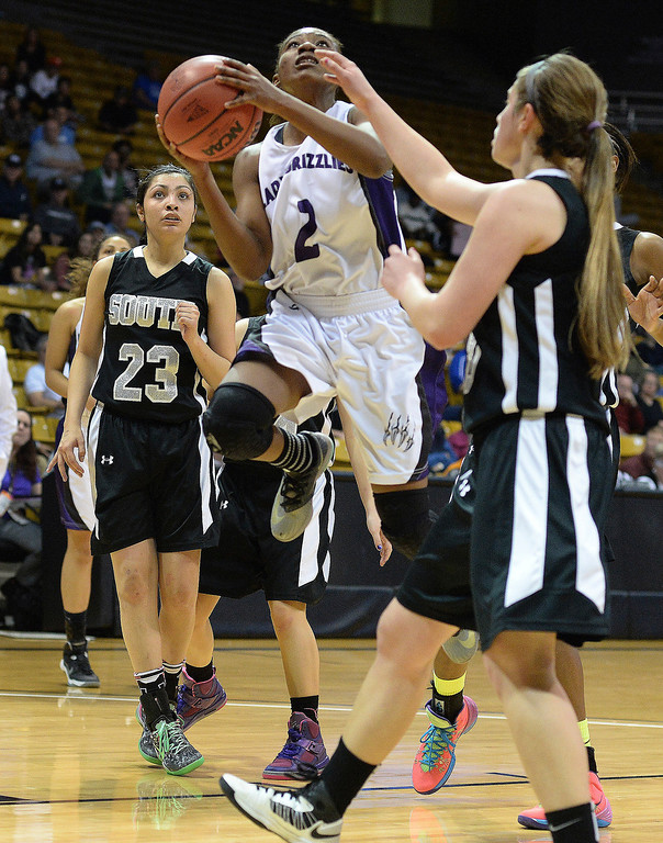 . Mesa Ridge senior guard Gabby Purnell (2) pushed through traffic in the second half. The Mesa Ridge High School girl\'s basketball team defeated Pueblo South 40-38 in a 4A semifinal game Thursday night, March 13, 2014 in Boulder, Colorado. (Photo by Karl Gehring/The Denver Post)