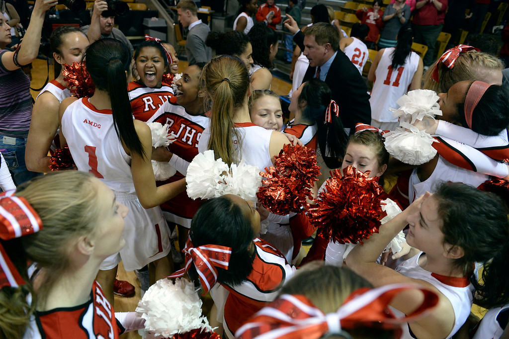 . Regis players and cheerleaders celebrated the win Thursday night as the Regis Jesuit High School girl\'s basketball team defeated Poudre 58-35 in a 5A semifinal game on March 13, 2014 in Boulder, Colorado. (Photo by Karl Gehring/The Denver Post)