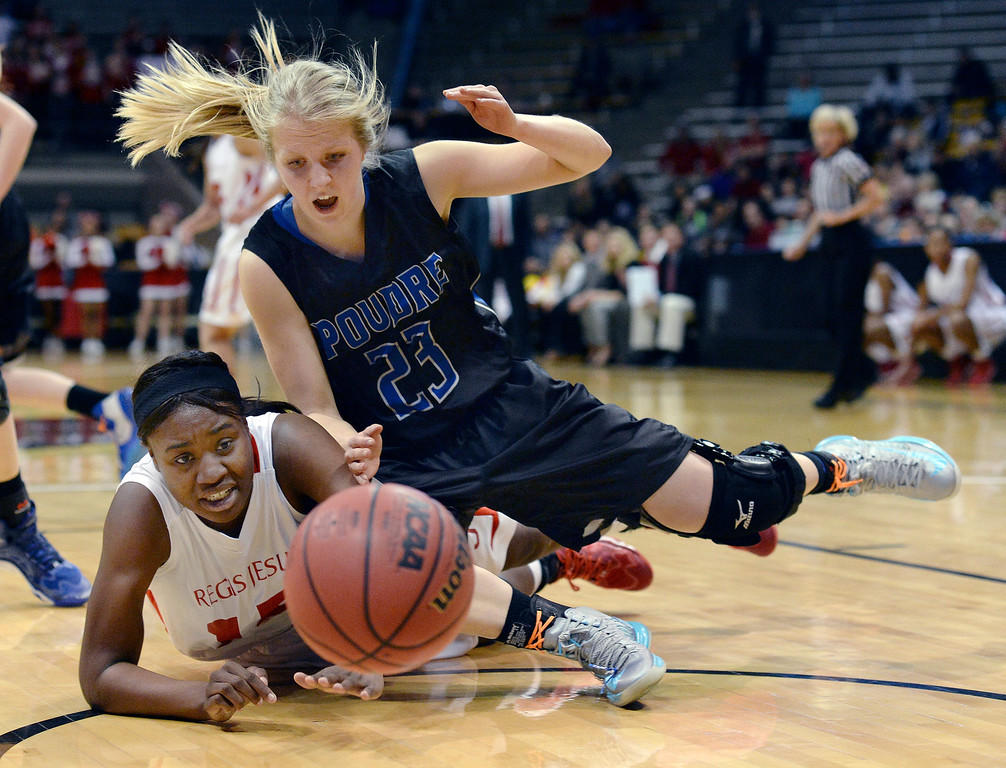 . Regis forward Diani Okigbogun (15) and Poudre senior McKenzie McDaniel (23) scrambled for a loose ball in the first half. The Regis Jesuit High School girl\'s basketball team took on Poudre in a 5A semifinal game Thursday night, March 13, 2014 in Boulder, Colorado. (Photo by Karl Gehring/The Denver Post)