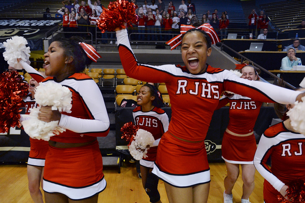 . Regis cheerleaders went wild in the closing minute as the Regis Jesuit High School girl\'s basketball team defeated Poudre 58-35 in a 5A semifinal game. (Photo by Karl Gehring/The Denver Post)