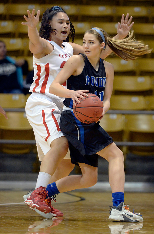 . Poudre senior Reagan Travis (11) looked for a way around Regis defender Kelsi Lidge (25) in the second half. Th (Photo by Karl Gehring/The Denver Post)