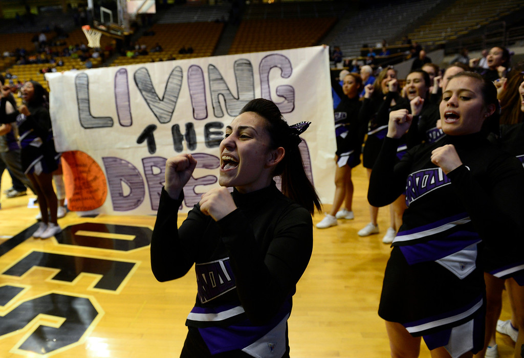 . BOULDER, CO - MARCH 15: The Mesa Ridge cheerleading squad pumps up their team as they introduce their players. The Broomfield Eagles girls basketball team takes on the Mesa Ridge Grizzlies in the Colorado 4A High School State Basketball Championships at the Coors Events Center on the University of Colorado campus in Boulder on March 15, 2014. (Kathryn Scott Osler The Denver Post)