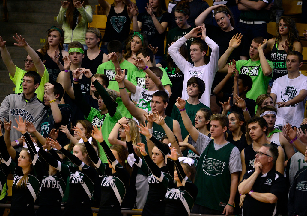 . BOULDER, CO - MARCH 15: The Fossil Ridge fan section cheers on their team. The Regis Jesuit Raiders take on the Fossil Ridge Sabercats in the Colorado 5A High School State Basketball Championships at the Coors Events Center on the University of Colorado campus in Boulder on March 15, 2014. (Kathryn Scott Osler The Denver Post)