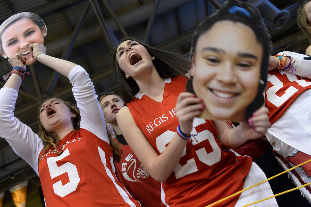 . BOULDER, CO - MARCH15: Regis seniors Mallory Kummer, left, and Madison Russell, center, cheered with cutouts of Anna Ptasinski (5) and Kelsi Lidge (25) during the second half. The Regis Jesuit High School girl\'s basketball team won the state 5A title with a decisive 60-34 win over Fossil Ridge in the championship game Saturday, March 15, 2014 in Boulder, Colorado. (Photo by Karl Gehring/The Denver Post)