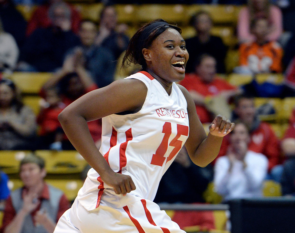 . BOULDER, CO - MARCH15: Regis forward Diani Okigbogun flashed a smile on the court following a basket in the fourth quarter. The Regis Jesuit High School girl\'s basketball team won the state 5A title with a decisive 60-34 win over Fossil Ridge in the championship game Saturday, March 15, 2014 in Boulder, Colorado. (Photo by Karl Gehring/The Denver Post)