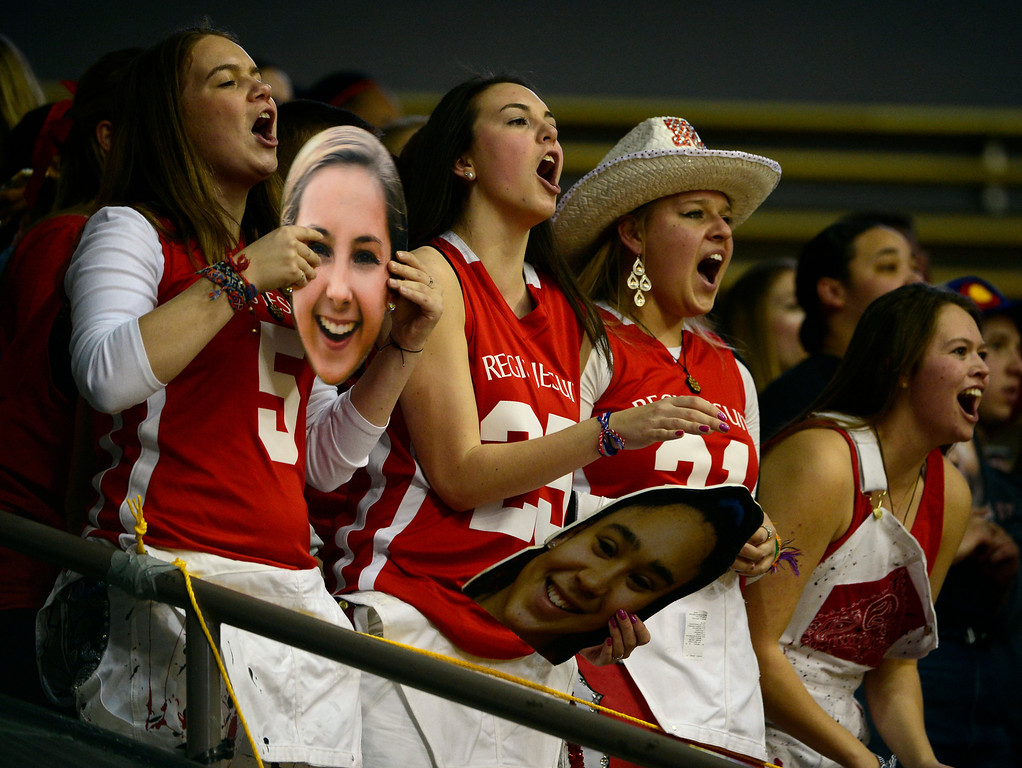. BOULDER, CO - MARCH 15: The Regis Jesuit student section cheers on their team. The Regis Jesuit Raiders take on the Fossil Ridge Sabercats in the Colorado 5A High School State Basketball Championships at the Coors Events Center on the University of Colorado campus in Boulder on March 15, 2014. (Kathryn Scott Osler The Denver Post)