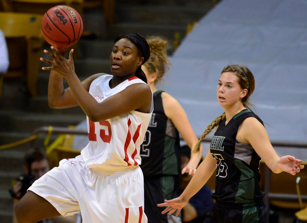 . BOULDER, CO - MARCH 15: Diani Akigbogun jumps up for the pass for Regis Jesuit in the second half. The Regis Jesuit Raiders take on the Fossil Ridge Sabercats in the Colorado 5A High School State Basketball Championships at the Coors Events Center on the University of Colorado campus in Boulder on March 15, 2014. (Kathryn Scott Osler The Denver Post)