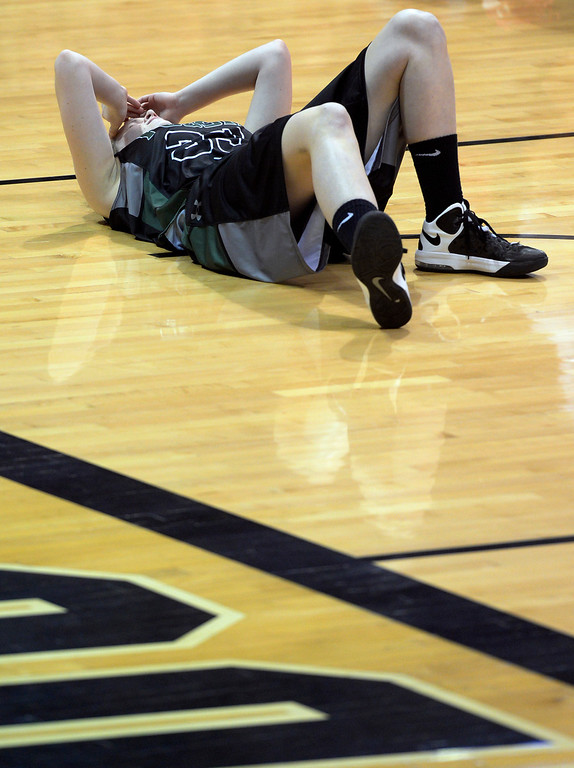 . BOULDER, CO - MARCH 15: Fossil Ridge\'s Regan Wess pauses after landing on the floor hard and hitting her head. The Regis Jesuit Raiders take on the Fossil Ridge Sabercats in the Colorado 5A High School State Basketball Championships at the Coors Events Center on the University of Colorado campus in Boulder on March 15, 2014. (Kathryn Scott Osler The Denver Post)