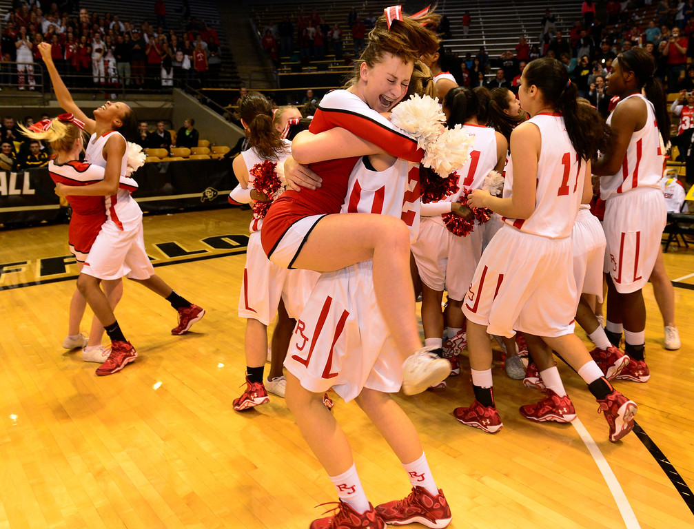 . BOULDER, CO - MARCH 15: Regis Jesuit celebrates their win. The Regis Jesuit Raiders take on the Fossil Ridge Sabercats in the Colorado 5A High School State Basketball Championships at the Coors Events Center on the University of Colorado campus in Boulder on March 15, 2014. (Kathryn Scott Osler The Denver Post)