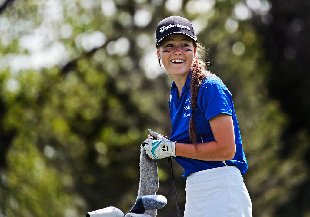 . LITTLETON, CO - MAY 20: Morgan Sahm, of Grandview High School is all smiles at Raccoon Creek Golf Course in Littleton, May 20, 2014. Sahm joined other class 5A girls golfers during the Colorado State High School Golf Tournament. (Photo by RJ Sangosti/The Denver Post)