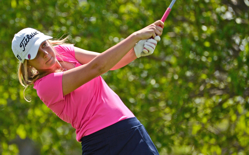 . LITTLETON, CO - MAY 20:  Jaylee Tait, of Columbine High School, tees off to start her day at Raccoon Creek Golf Course in Littleton, May 20, 2014. Tait joined other class 5A girls golfers during the Colorado State High School Golf Tournament. (Photo by RJ Sangosti/The Denver Post)
