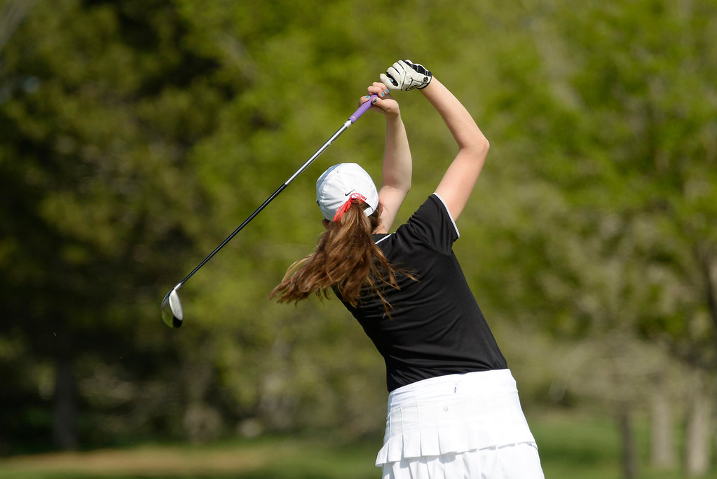 . LITTLETON, CO - MAY 20: Madison McCambridge, of Fairview High School, tees off of hole two at Raccoon Creek Golf Course in Littleton, May 20, 2014. McCambridge joined other class 5A girls golfers during the Colorado State High School Golf Tournament. (Photo by RJ Sangosti/The Denver Post)
