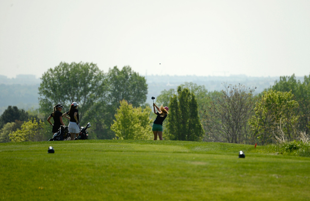 . LITTLETON, CO - MAY 20: Joanna Kempton, of Heritage High School, tees off at hole four at Raccoon Creek Golf Course in Littleton, May 20, 2014. Kempton joined other class 5A girls golfers during the Colorado State High School Golf Tournament. (Photo by RJ Sangosti/The Denver Post)