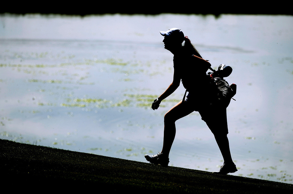 . LITTLETON, CO - MAY 20: Madison McCambridge, of Fairview High School, walks to the green at Raccoon Creek Golf Course in Littleton, May 20, 2014. McCambridge joined other class 5A girls golfers during the Colorado State High School Golf Tournament. (Photo by RJ Sangosti/The Denver Post)