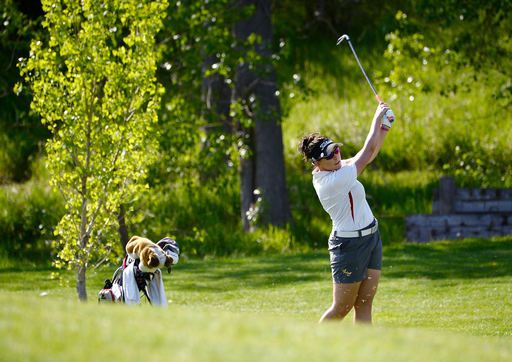 . LITTLETON, CO - MAY 20: Reagan Ritchey, of Brighton High School, chips onto the green on hole one at Raccoon Creek Golf Course in Littleton, May 20, 2014. Ritchey joined other class 5A girls golfers during the Colorado State High School Golf Tournament. (Photo by RJ Sangosti/The Denver Post)