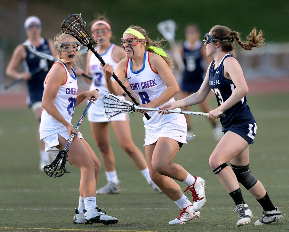 . DENVER, CO - APRIL 9:  Cherry Creek attack Colby Goettelman (8) picked up the ball after a turnover and converted it into a goal late in the second half. Goettelman had five goals to lead the Bruins past Mullen Wednesday, April 9, 2014. Creek is the defending girl\'s lacrosse state champion.  (Photo by Karl Gehring/The Denver Post)