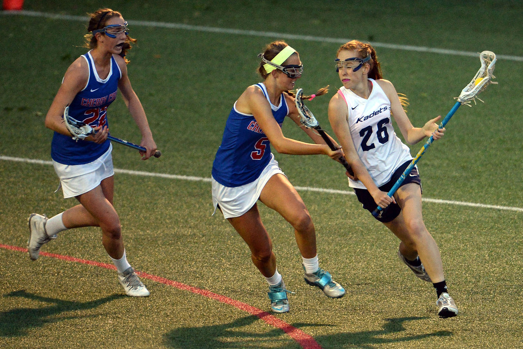 . Emily Trousil (26) of the Air Academy Kadets brings the ball up field as Nell List (5) of the Cherry Creek Bruins and Caroline Perry (22) defend during Academy\'s 11-10 girls 5A championship game win. (Photo by AAron Ontiveroz/The Denver Post)