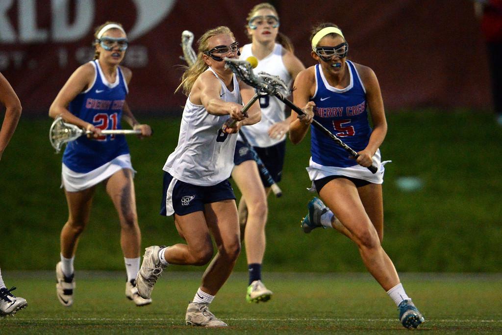 . Katey Holmes (6) of the Air Academy Kadets makes a big save as Nell List (5) of the Cherry Creek Bruins attempted to break into the open field down just one goal in the second half during Academy\'s 11-10 girls 5A championship game win. (Photo by AAron Ontiveroz/The Denver Post)