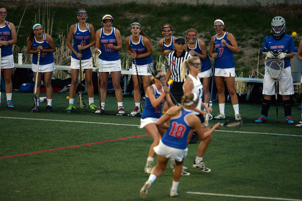 . The Cherry Creek Bruins bench cheers their teammates on against the Air Academy Kadets during Academy\'s 11-10 girls 5A championship game win. (Photo by AAron Ontiveroz/The Denver Post)
