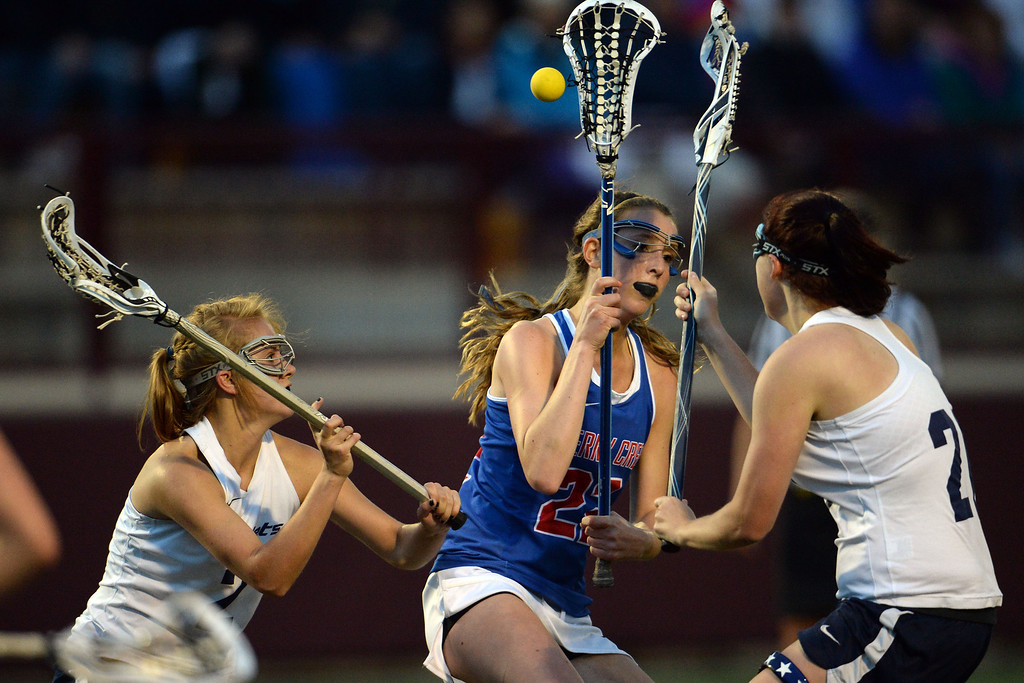 . Caroline Perry (22) of the Cherry Creek Bruins is defended by Natalie Berg (2) of the Air Academy Kadets and Hannah Davis (21) during Academy\'s 11-10 girls 5A championship game win. (Photo by AAron Ontiveroz/The Denver Post)