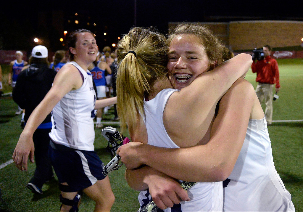 . Sawyer Sack (10) of the Air Academy Kadets hugs Maddie Jahelka (8) of the Air Academy Kadets after their 11-10 girls 5A championship game win over the Cherry Creek Bruins.   (Photo by AAron Ontiveroz/The Denver Post)